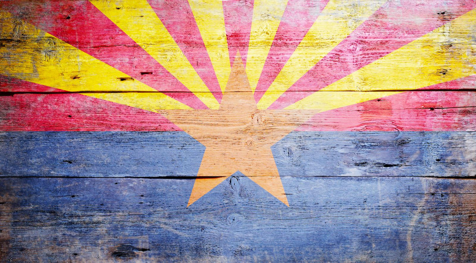 Arizona state flag washed out on reclaimed wood