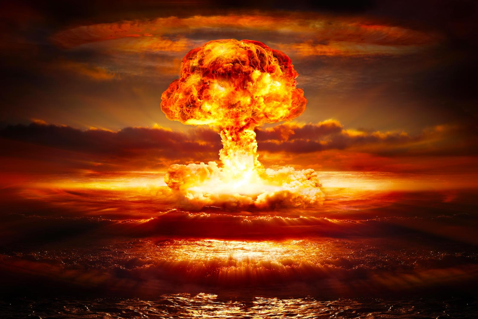 Nuclear explosion going off in the ocean creating a mushroom cloud