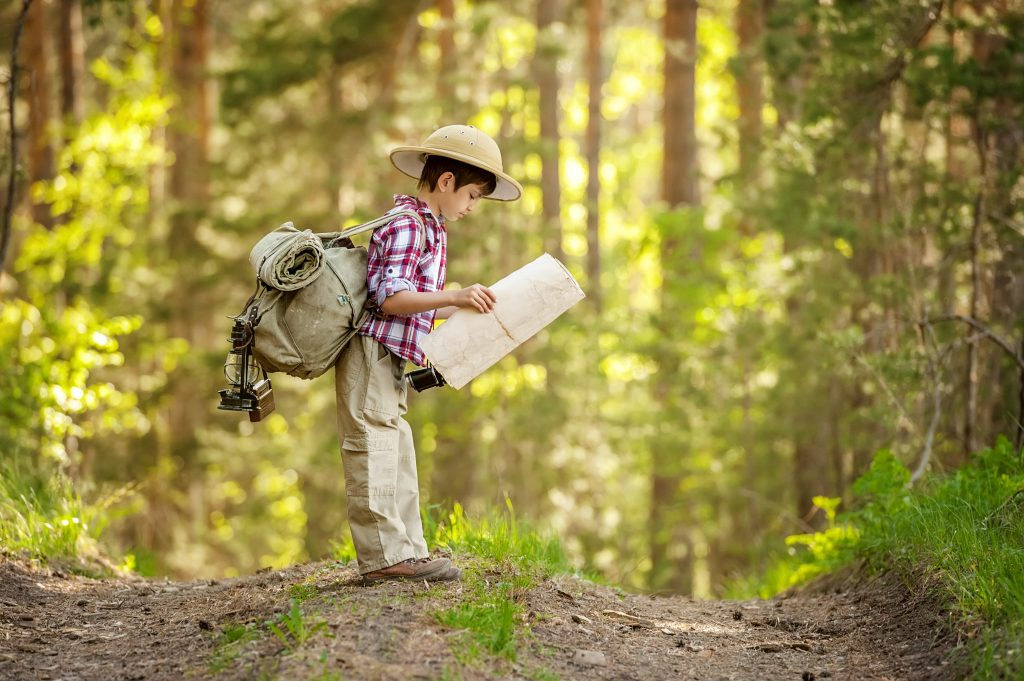 boy reading map for survival skills