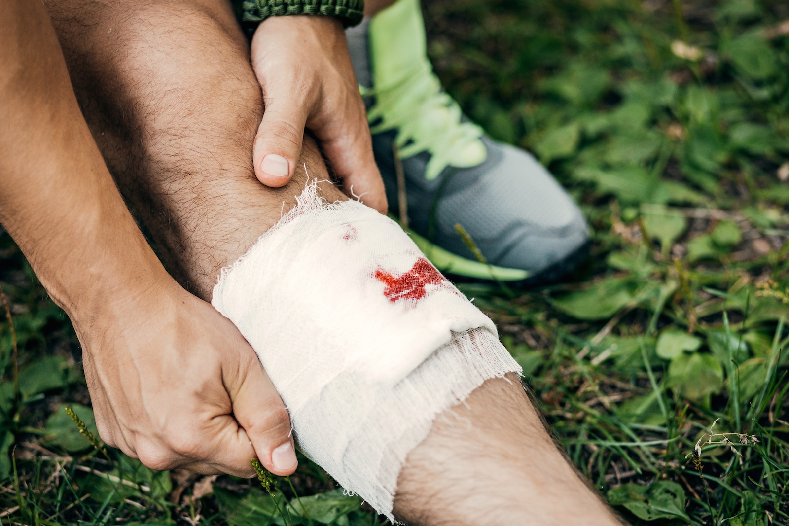dressing a wound while hiking
